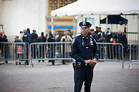 An NYPD officer stands guard over the frozen zone in front of the New York Stock Exchange on Monday, September 19, 2011 during a visit by the President of South Africa during the opening week of the United Nations General Assembly. (© Richard B. Levine)