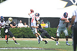 Ole Miss' Zack Stoudt (8) is hit by Vanderbilt defensive end Walker May (90) , forcing an errant throw and an interception by Vanderbilt cornerback Trey Wilson (8) in Nashville, Tenn. on Saturday, September 17, 2011. Wilson scored on the play. Vanderbilt won 30-7..
