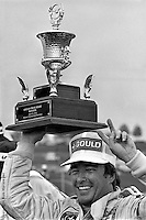 HAMPTON, GA - APRIL 22: Johnny Rutherford celebrates with the trophy in Victory Lane after winning the Gould Twin Dixie 125 event on April 22, 1979, at Atlanta International Raceway near Hampton, Georgia.