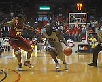 "Ole Miss guard Chris Warren (12)  drives against Arkansas' Julysses Nobles (23)  at C.M. ""Tad"" Smith in Oxford, Miss. on Saturday, March 5, 2010. Ole Miss won 84-74."