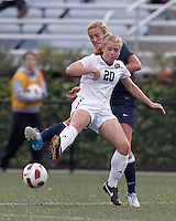 Yale University defender Christina Bradley (9) and Harvard University midfielder Lauren Urke (20) battle for the ball. In overtime, Harvard University defeated Yale University,1-0, at Soldiers Field Soccer Stadium, on September 29, 2012.