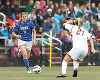 Duke University forward Kelly Cobb (9) on the attack. Boston College (white) defeated Duke University (blue/white), 4-1, at Newton Campus Field, on October 6, 2013.