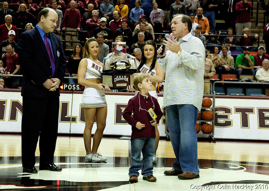 TALLAHASSEE, FL 2/1/11-FSU-WF MBB11 CH-Florida State Head Football Coach Jimbo Fisher is joined by son Ethan as talks about the Chick-fil-A Bowl during half time of the Wake Forest game Tuesday at the Donald L. Tucker Center in Tallahassee. .COLIN HACKLEY PHOTO