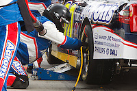 Feb. 21, 2010, Auto Club Speedway, CA: Pit Crew members of David Reutimann work to make a quick change in Fontana, CA.