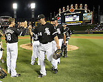 CHICAGO - JUNE 23:  Paul Konerko #14 and other members of the Chicago White Sox celebrate after the game against the Milwaukee Brewers on June 23, 2012 at U.S. Cellular Field in Chicago, Illinois.  The White Sox defeated the Brewers 8-6.  (Photo by Ron Vesely)  Subject:  Paul Konerko
