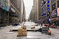 Workers prepare the 180 foot long toboggan run on Super Bowl Boulevard in Midtown Manhattan in New York on Sunday, January 26, 2014. Despite the game being held in New Jersey on February 2 sports fans are expected to pack New York to take part in the multitude of activities planned around the game including the 13 block stretch of Broadway, running from 34th street through 47th street that will host Super Bowl Blvd. from January 29 to February 1. (© Richard B. Levine)