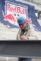 A worker signs the last piece of steel prior to it being placed during the topping off ceremony at Red Bull Arena in Harrison, NJ, on April 14, 2009.