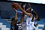 04 November 2015: North Carolina's Stephanie Watts (right) and Wingate's Courtney Robinson (23). The University of North Carolina Tar Heels hosted the Wingate University Bulldogs at Carmichael Arena in Chapel Hill, North Carolina in a 2015-16 NCAA Women's Basketball exhibition game. UNC won the game 86-84.
