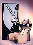 Fashion accessory still life of stylish high heel womens shoes and a clutch handbag