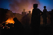 A family prepares a fire of coal for the process of coking coal in Laltengunj village in Jharia, Jharkhand, India.