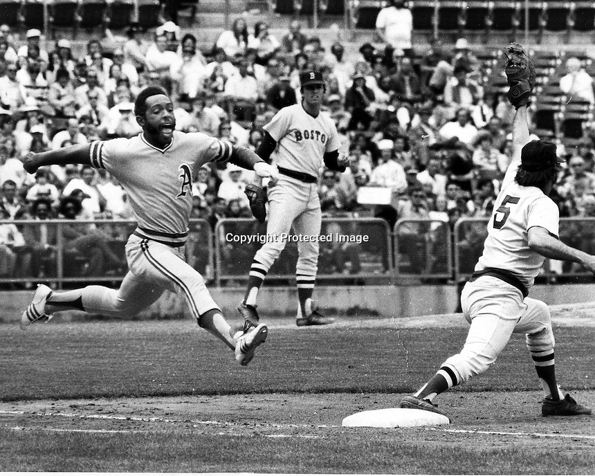 Oakland A's outfielder Billy North leaps toward first base against the Boston Red Sox. (1973 photo by Ron Riesterer/photoshelter)
