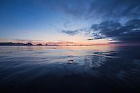 Dawn over calm sea near Tasiilaq, east Greenland