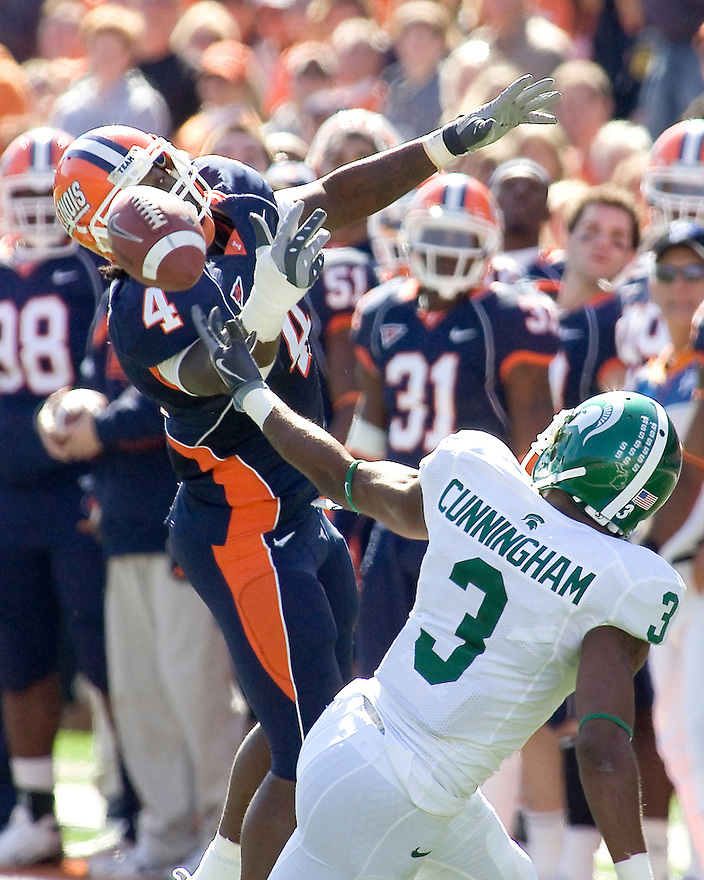 October 9, 2009 - Champaign, Illinois, USA - Illinois Donsay Hardeman (4) prevents Michigan State receiver B.J. Cunningham (3) from catching a pass in the game between the University of Illinois and Michigan State at Memorial Stadium in Champaign, Illinois.  Michigan State defeated Illinois 24 to 14.  .