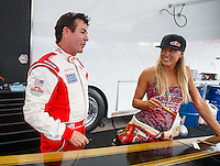 Sep 2, 2016; Clermont, IN, USA; Papa Johns pizza founder John Schnatter  (left) with Leah Pritchett during NHRA qualifying for the US Nationals at Lucas Oil Raceway. Mandatory Credit: Mark J. Rebilas-USA TODAY Sports