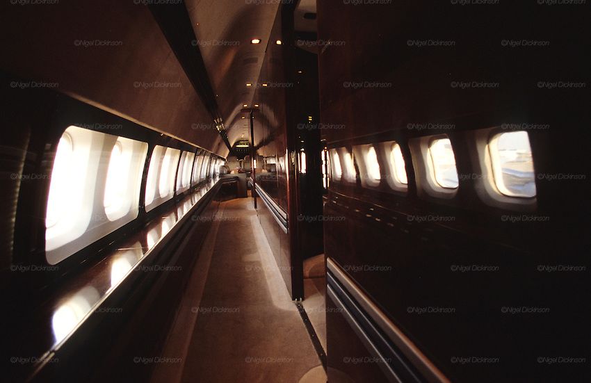 "Interior of John Travolta's jumbo jet. Interior of fuselage, cabin corridor..John Travolta is pilot of his very own jumbo jet, a 1964 Boeing 707-100 series. In 2003, John Travolta flew his jumbo jet around the world, in partnership with Quantas, to rekindle confidence in commercial aviation, and to remind us that elegance and style are a part of flying. The crew are dressed in tailor made authentic uniforms from the Quantas museum. The men's uniforms are styled on British Naval uniforms and the ladies' designed by Chanel. His jumbo jet sports a personalised number plate N707JT which speaks for itself. The aircraft is named ""Jett Clipper Ella"" dedicated to his son and daughter. This jumbo together with his other aircraft are housed in purpose built hangars at his home in Florida, USA."