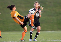 BOYDS, MARYLAND-JULY 07,2012:  Ashley Herndon (15) of DC United Women battles for the ball with Larissa Najjar (9) of Dayton Dutch Lions during a W League game at Maryland Soccerplex, in Boyds, Maryland. DC United women won 4-1.
