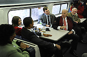 Baltimore, MD - January 17, 2009 -- United States Vice President-elect Joe Biden and President-elect Barack Obama talk to train passengers on the Whistle Stop Train Tour outside of Baltimore, Maryland on Saturday, January 17, 2009. The ceremonial trip will carry President-elect Obama, Vice President-elect Biden and their families to Washington for their inaugurations with additional events in Philadelphia, Wilmington and Baltimore. Obama will be sworn in as the 44th President of the United States on January 20, 2009. .Credit: Kevin Dietsch - Pool via CNP