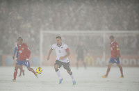 Commerce City,  Co - Friday, March 22, 2013: USA 1-0 over Costa Rica at Dick's Sporting Goods Park during World Cup Qualifying. Clint Dempsey dribbles the ball in a snow storm.
