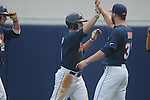 Ole Miss' Auston Bousfield (9) hits a two run home run and is congratulated by Brett Huber (38) vs. Lipscomb at Oxford-University Stadium in Oxford, Miss. on Saturday, March 9, 2013. Ole Miss won 8-5. The win was the 486th for Mike Bianco as the Rebel head coach, making him the university's all time winningest baseball coach.