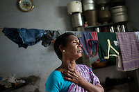Indra (42 years) in her one roomed house given by CASA (NGO) at Cuddalore, Tamil Nadu, India.