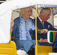 Prince Charles and Duchess Camilla ride off in a rickshaw race - London