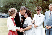 United States President Ronald Reagan and first lady Nancy Reagan comfort Sherry Sierralta beside the grave of her brother, slain Navy diver Robert Dean Stethem, at Arlington National Cemetery on Tuesday, July 2, 1985.  Looking on are Maria Dennison, a close friend, and the family minister.<br /> Mandatory Credit: Bill Fitz-Patrick - White House via CNP