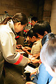 "KIDZANIA TOKYO, ""Edutainment City"",.children getting paid for their fireman services."