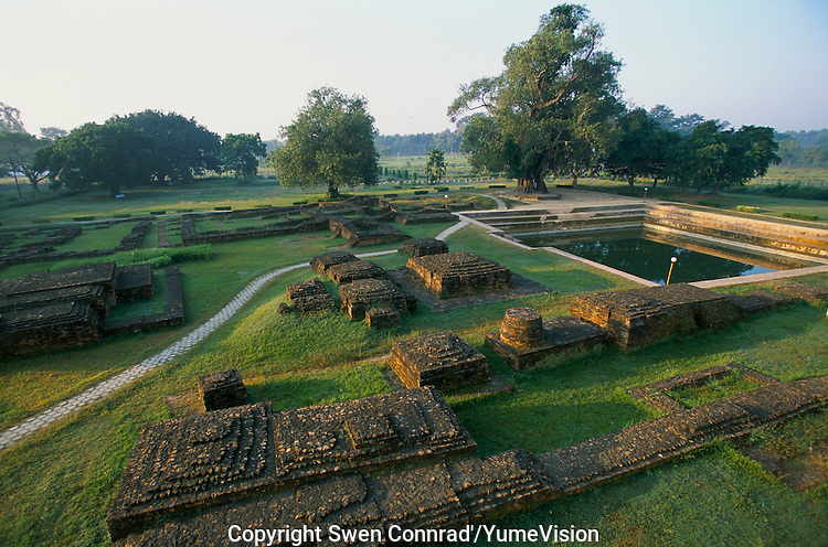 Sun raise on the ruins of former monastery and temple at the Maya Devi Temple in Lumbini Nepal, marks the birth place of Siddhartha Gautam Buddha.  In 1976, the Nepalese Government and UNESCO designated Lumbini as a world heritage site..-The full text reportage is available on request in Word format