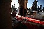 A Palestinian man reads the Qur'an during the holy fasting month of Ramadan at al-Aqsa mosque, Islam's third holiest site, in Jerusalem's Old City on June 30, 2014. Muslim believers abstain from eating, drinking, smoking and having sex from dawn until sunset. Ramadan is sacred to Muslims because it is during that month that tradition says the Koran was revealed to the Prophet Mohammed. Photo by Saeed Qaq
