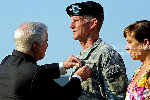 United States Secretary of Defense Robert M. Gates, left, awards the Distinguished Service Medal to U.S. Army General Stanley A. McChrystal with is wife Annie as he is honored at a retirement ceremony at Fort McNair in Washington, Friday, July 23, 2010. .Mandatory Credit: Jerry Morrison - U.S. Army via CNP