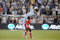 Graham Zusi (blue) Sporting KC, Dominic Oduro, Chicago...Sporting KC and Chicago Fire played to a scoreless tie in the inaugural game at LIVESTRONG Sporting Park, Kansas City, Kansas.