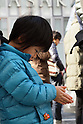 March 11, 2012, Tokyo, Japan - A Child takes part in a moment of silence at 2:46 p.m. in Ginza, Tokyo, March 11, 2012, to mark the first anniversary of the earthquake and tsunami disaster that killed thousands people and set off a nuclear crisis. (Photo by Yosuke Tanaka/AFLO) -bun-