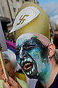 Angry and colourful make-up, a demonstrator has clear ideas about the Pope political inclination.