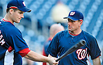 29 September 2009: Washington Nationals' Batting Coach Rick Eckstein (right) gives instruction to Josh Willingham prior to a game against the New York Mets at Nationals Park in Washington, DC. The Nationals rallied to defeat the Mets 4-3 in the second game of their final 3-game home series. Mandatory Credit: Ed Wolfstein Photo