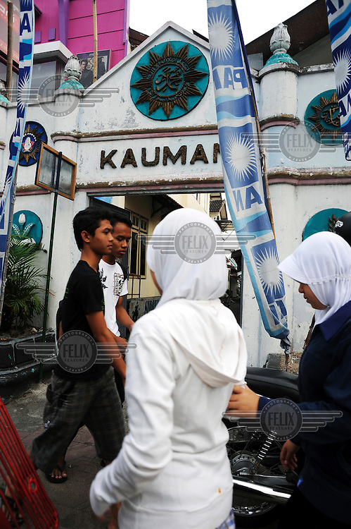 People pass the entrance gate to the Islamic neighbourhood of Kauman in central Yogyakarta.
