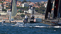 PORTUGAL, Cascais. 5th August 2011. America's Cup World Series. Practice day. ORACLE Racing Coutts, with ALEPH in the background.