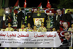 Palestinian supporters of Hamas movement hold placards and turkish flags during a rally to celebrate the the victory of Turkey's Prime Minister Recep Tayyip Erdogan in the local turkish elections, in the northern Gaza Strip, March 31, 2014. Photo by Mohammed Asad
