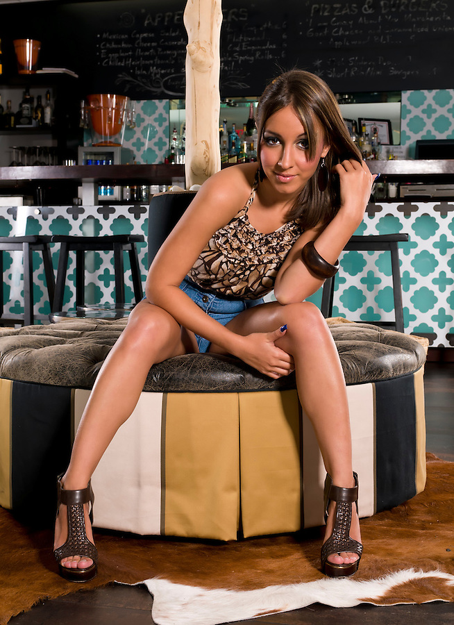 Young aattractive woman seated in a bar