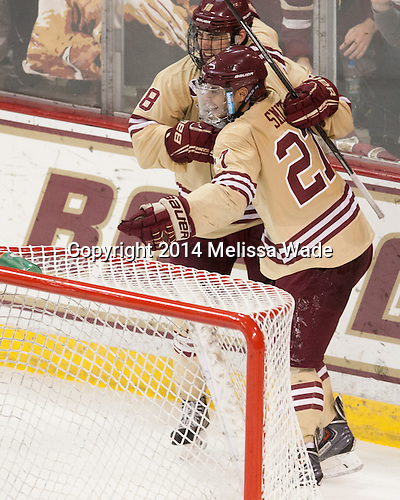 Michael Sit (BC - 18), Quinn Smith (BC - 27) - The Boston College Eagles defeated the visiting University of Michigan Wolverines 5-1 (EN) on Saturday, December 13, 2014, at Kelley Rink in Conte Forum in Chestnut Hill, Massachusetts.