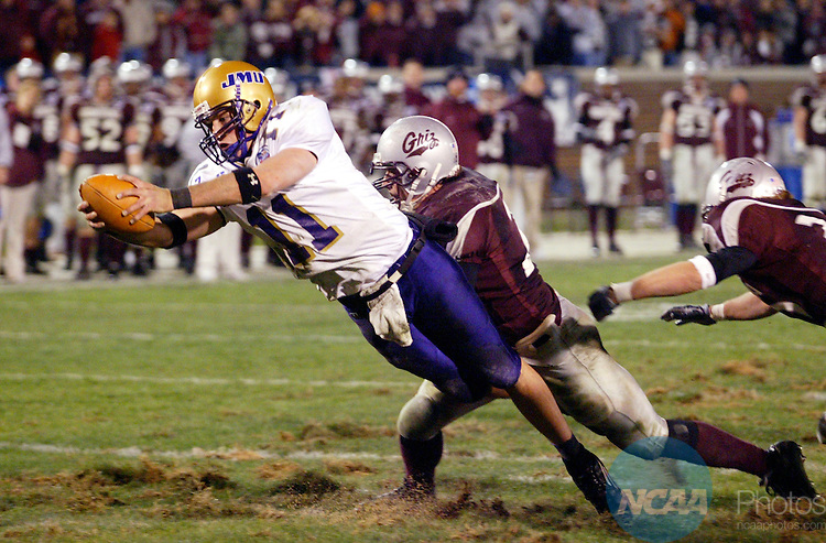 17 DEC 2004:  Quarterback Justin Rascati (11) of James Madison dives across the goal line for a touchdown against  Montana University during the Division 1-AA Men's Football Championship held at Finley Stadium in Chattanooga, TN.  James Madison defeated Montana 31-21 for the national title.  Jamie Schwaberow/NCAA Photos