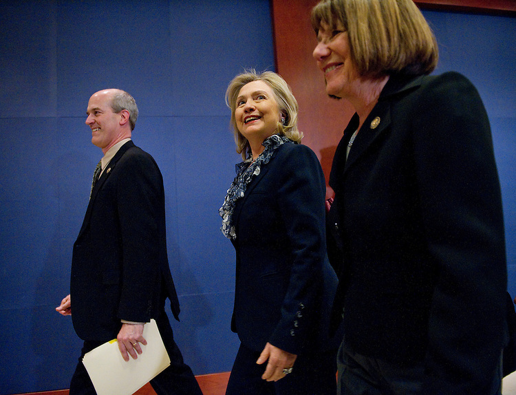 WASHINGTON, DC - March 30: Rep. Rick Larsen, D-Wash., Secretary of State Hillary Rodham Clinton and Rep. Susan A. Davis, D-Calif., arrive for a bipartisan briefing by Clinton and Defense Secretary Robert M. Gates on the situation in Libya for members of the U.S. House of Representatives. (Photo by Scott J. Ferrell/Congressional Quarterly)