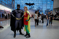 New York City, NY. 10 October 2014. A couple dress up as Batman and Robin take part during the 2014 New York Comic Con fair at the Jacob Javits Center. Photo by Kena Betancur/VIEWpress