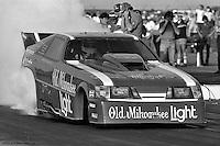POMONA, CALIFORNIA: John Lombardo drives the Raymond Beadle Blue Max Funny Car during a 1985 NHRA drag race at Pomona, California.