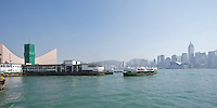 Arriving at the Tsim Sha Tsui Star Ferry terminal, as another in the fleet departs
