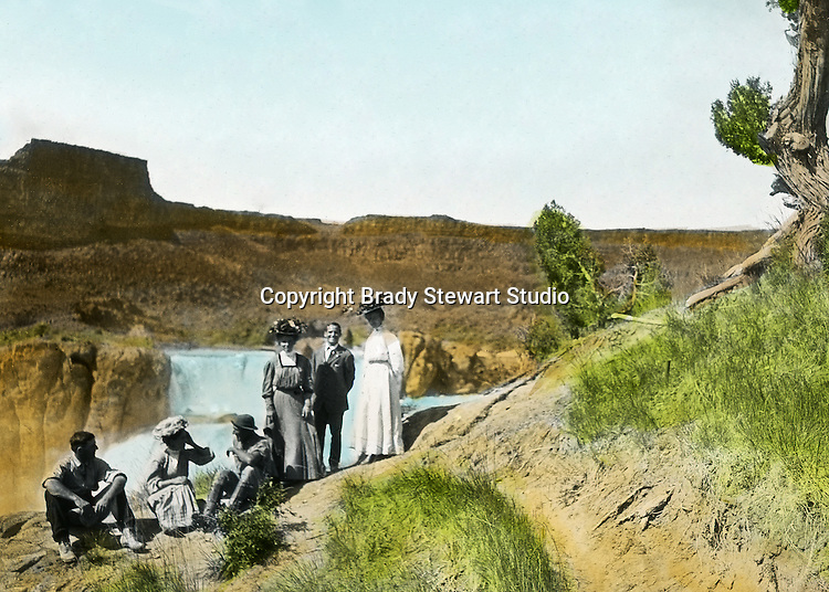 Twin Falls ID:  Idaho Homesteaders and their visitors from Pittsburgh visitng the sights - 1910.   Brady Stewart and three friends went to Idaho on a lark from 1909 thru early 1912.  As part of the Mondell Homestead Act, they received a grant of 160 acres north of the Snake River.  Brady Stewart photographed the adventures of farming along with the spectacular landscapes. To give family and friends a better feel for the adventure, he hand-color black and white negatives into full-color 3x4 lantern slides.  The Process:  He contacted a negative with another negative to create a positive slide.  He then selected a fine brush and colors and meticulously created full color slides.