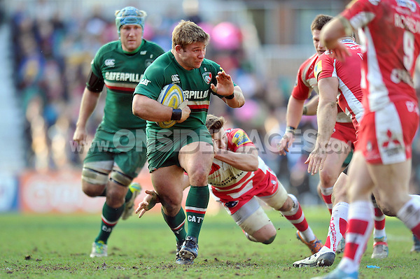Tom Youngs takes on the Gloucester defence. Aviva Premiership match, between Leicester Tigers and Gloucester Rugby on February 16, 2014 at Welford Road in Leicester, England. Photo by: Patrick Khachfe / JMP
