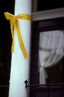 Yellow ribbon tied around front porch column.
