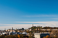 Calton Hill seen from Holyrood Park, Edinburgh, Scotland. The Calton Hill is an iconic hill in Edinburgh, and is the location of several of the known city landmarks and monuments such as the Nelson's Monument or the Edinburgh Observatory. The Holyrood Palace and Scottish Parliament are also visible, as well as the Balmoral hotel clock tower and the Scott Monument.