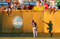 June 26, 2010; Omaha, NE, USA; Clemson Tigers outfielder Addison Johnson (18) throws a ball to fans after a catch against the South Carolina Gamecocks in game 14 of the 2010 College World Series at Rosenblatt Stadium. Mandatory Credit: Crystal LoGiudice-US PRESSWIRE.