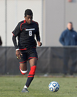Northeastern University forward Terence Carter (8) brings the ball forward. .NCAA Tournament. University of Connecticut (white) defeated Northeastern University (black), 1-0, at Morrone Stadium at University of Connecticut on November 18, 2012.